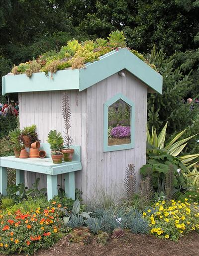 Things to do in the garden during september rated people for Garden potting sheds designs