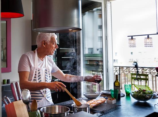 man cooking in modern kitchen