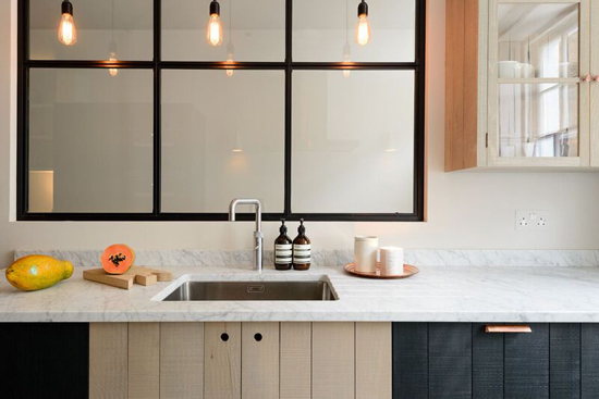 timber brass and marble kitchen