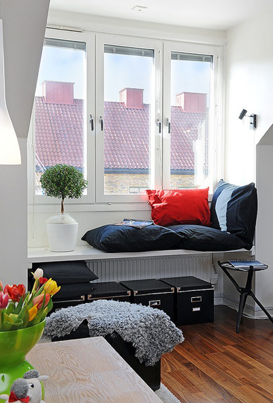 Window sill with red pillow