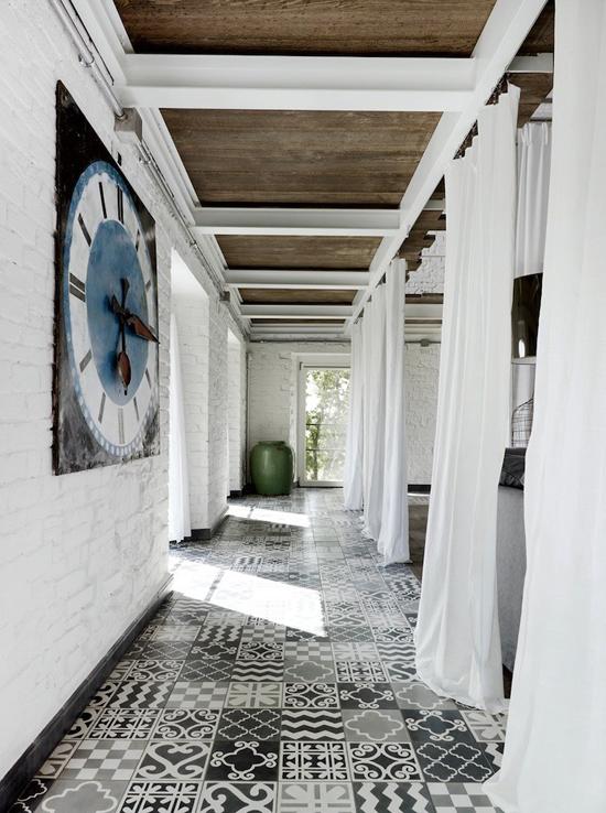 patchwork tiles on hallway floor