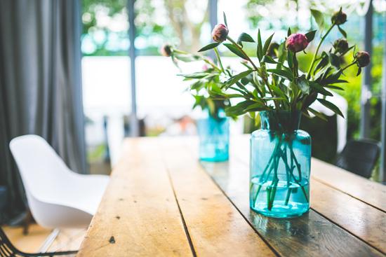 peonies in a blue jar