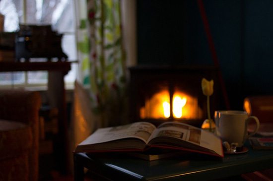 book by fireplace