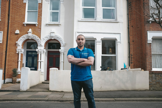 Tradespeople stories: Hassan of Canvas Decorators Ltd poses with his arms crossed in front of the camera