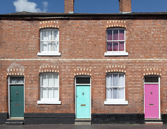 row of terrace houses with colourful doors
