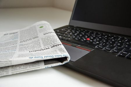 newspaper-and-laptop