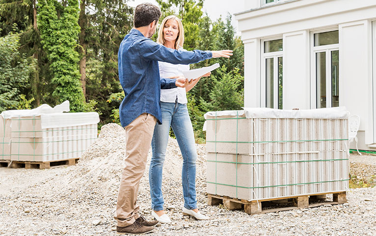 homeowner and tradesperson discussing materials