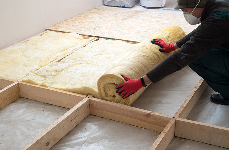 Person laying loft insulation