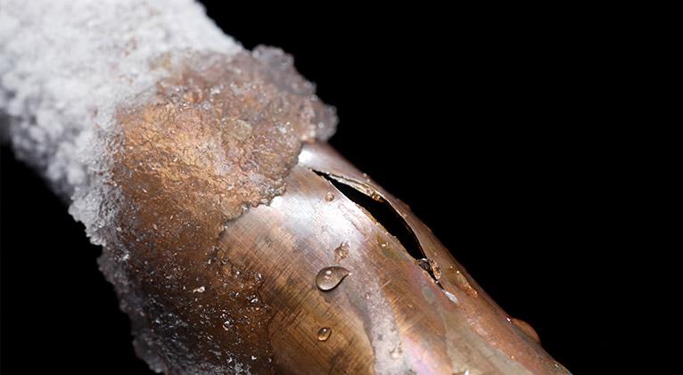 Copper pipe, frozen and split