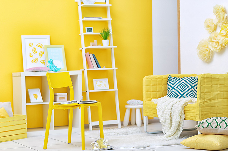 Room decorated and furnished in yellow and white