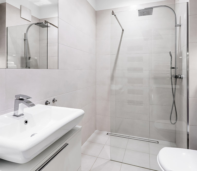 Wet room with a large shower section and no bath