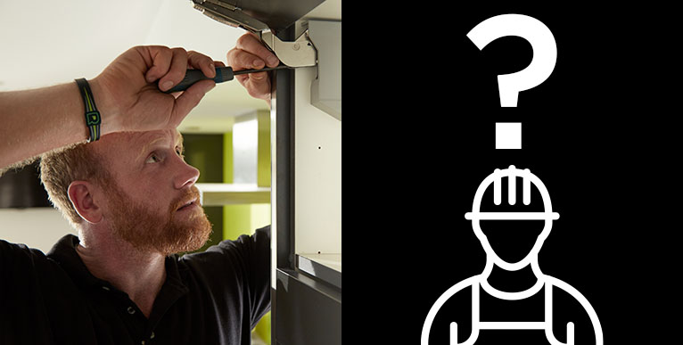 A handyman working in a door frame who looks a little like Prince Harry