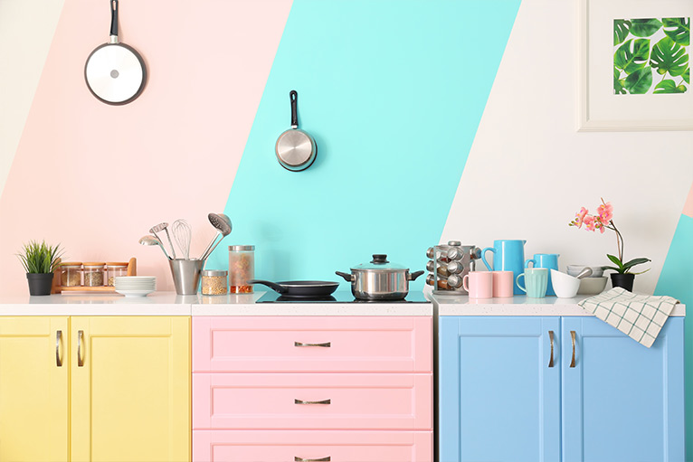 Kitchen design trend - cabinets and drawers in pastel yellow, pink and blue colours