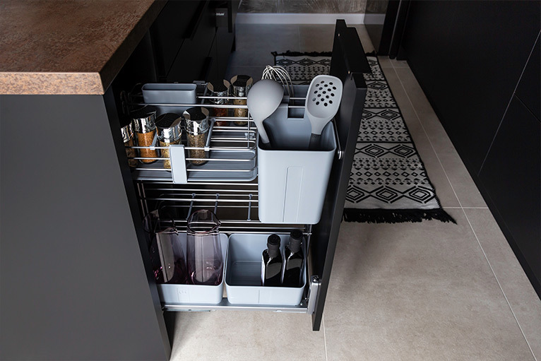 Kitchen design trend - concealed pull-out storage cabinet