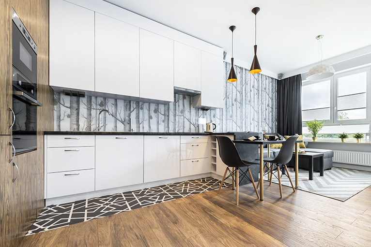 Kitchen design trend - open plan kitchen with black and white patterned tiles
