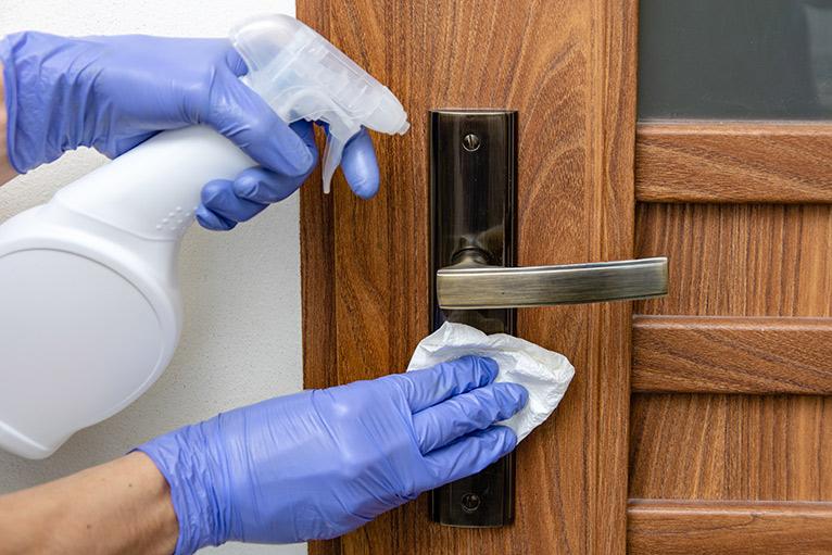 Coronavirus: Disinfecting a door