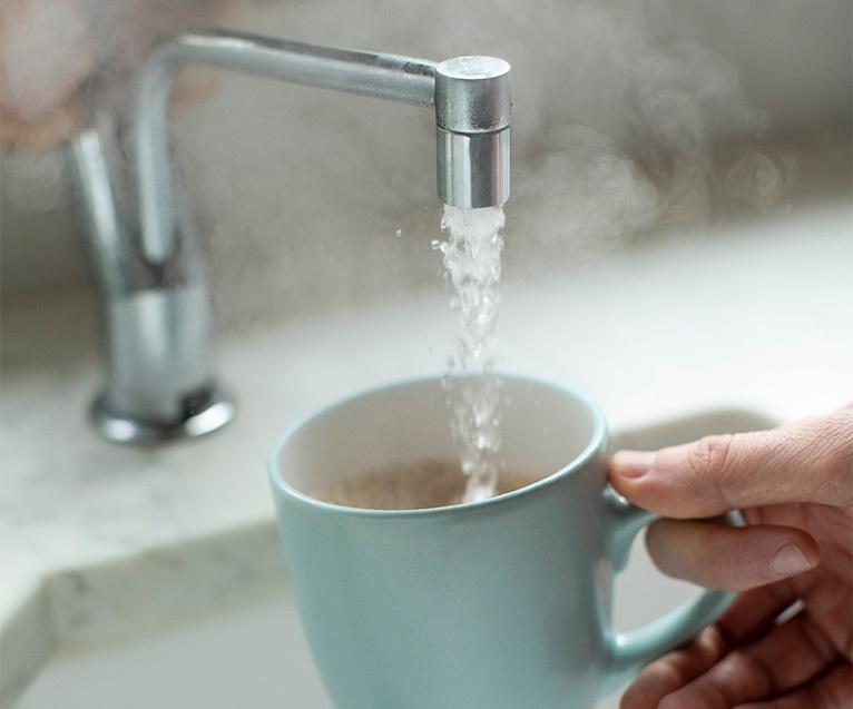 Boiling water tap filling tea mug