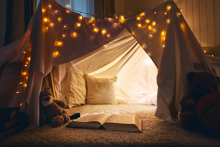 Kids tent made with bedsheets in a cosy living room