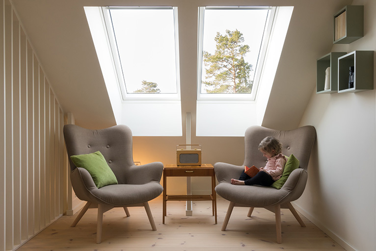 Two reading chairs under an eaves roof