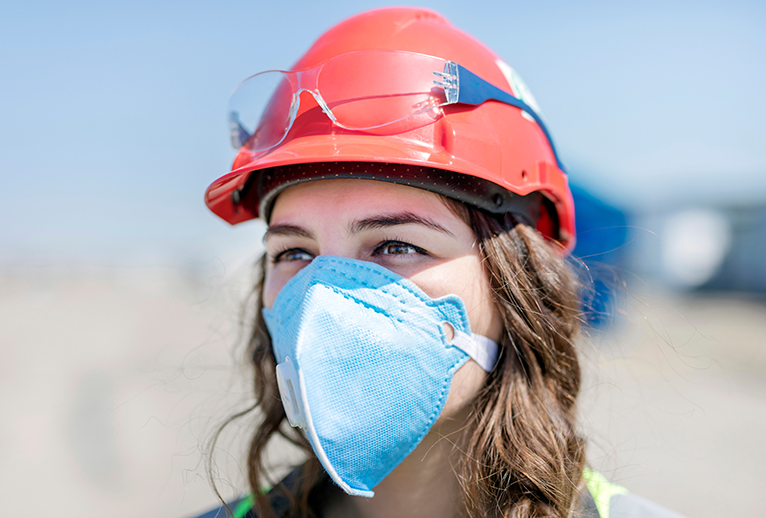 Girl in hard hat and mask