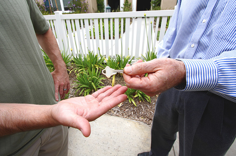 Key being handed to a builder