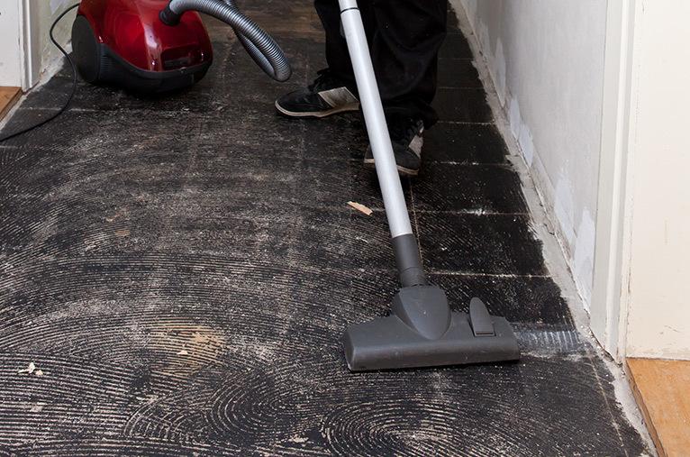 Corridor being vacuumed