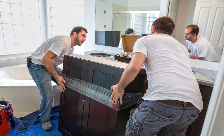 Two men moving a piece of furniture