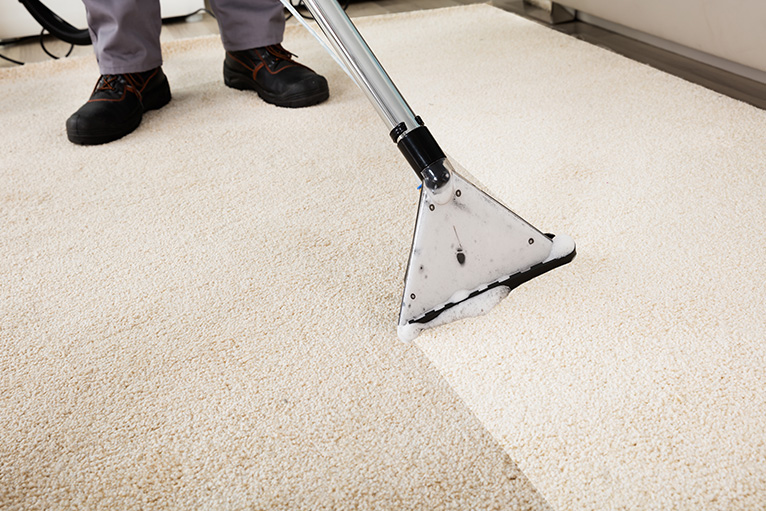 Cream colour carpet being cleaned