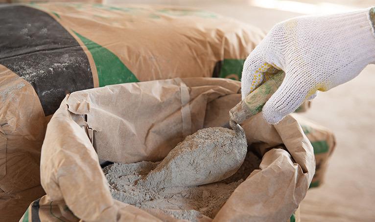 Preparing cement wearing gloves