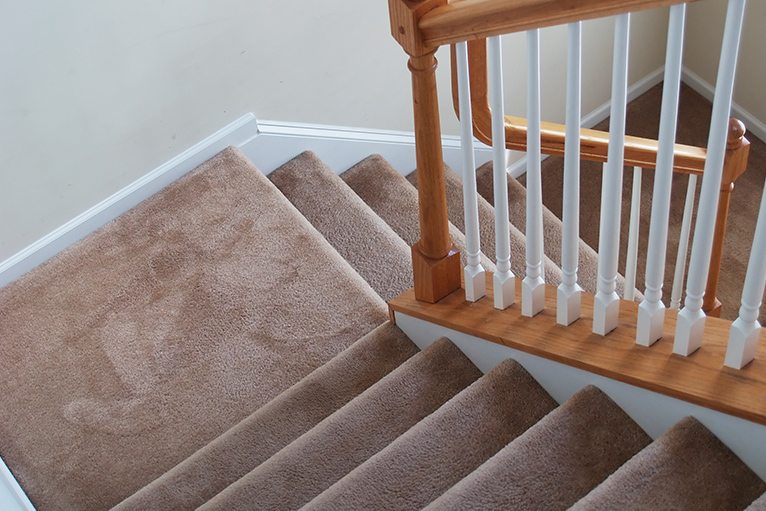 Carpeted stairs over landing