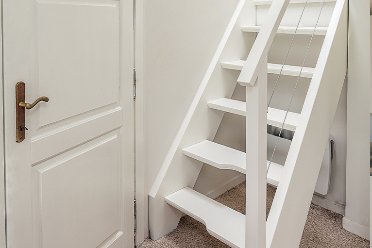 White paddle staircase leading upstairs