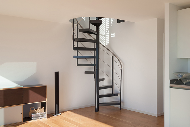 Staircase with metal steps spiralling upwards