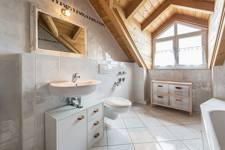Spacious white bathroom with wooden loft ceiling