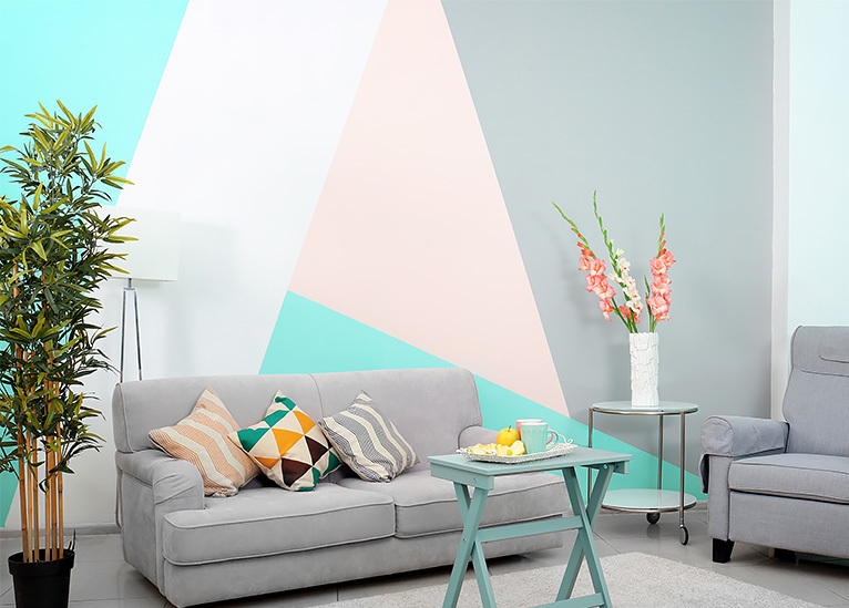 Bright blue, pink and grey geometric print feature wall