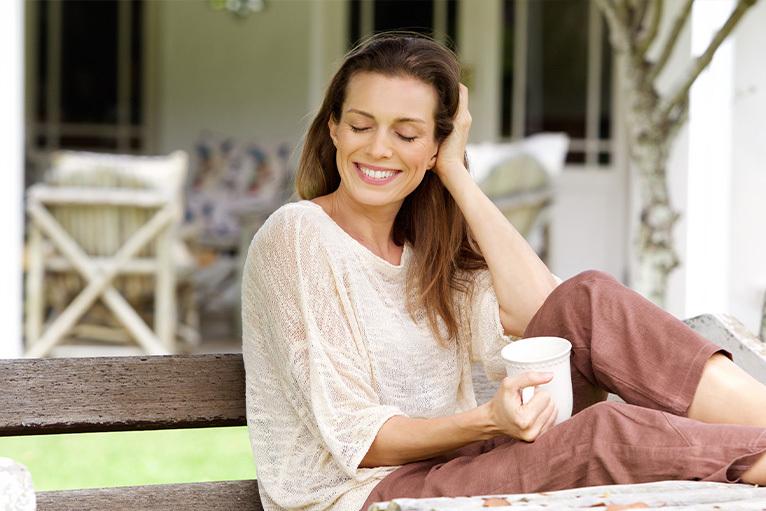 Woman relaxing in her garden