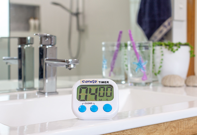 Shower timer on bathroom counter