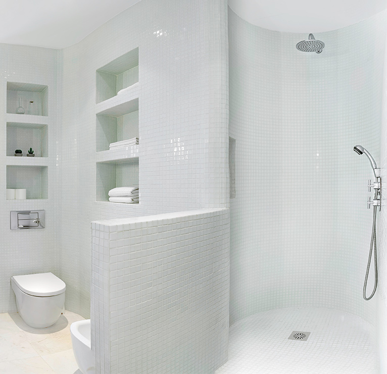 All-white bathroom with walk-in shower