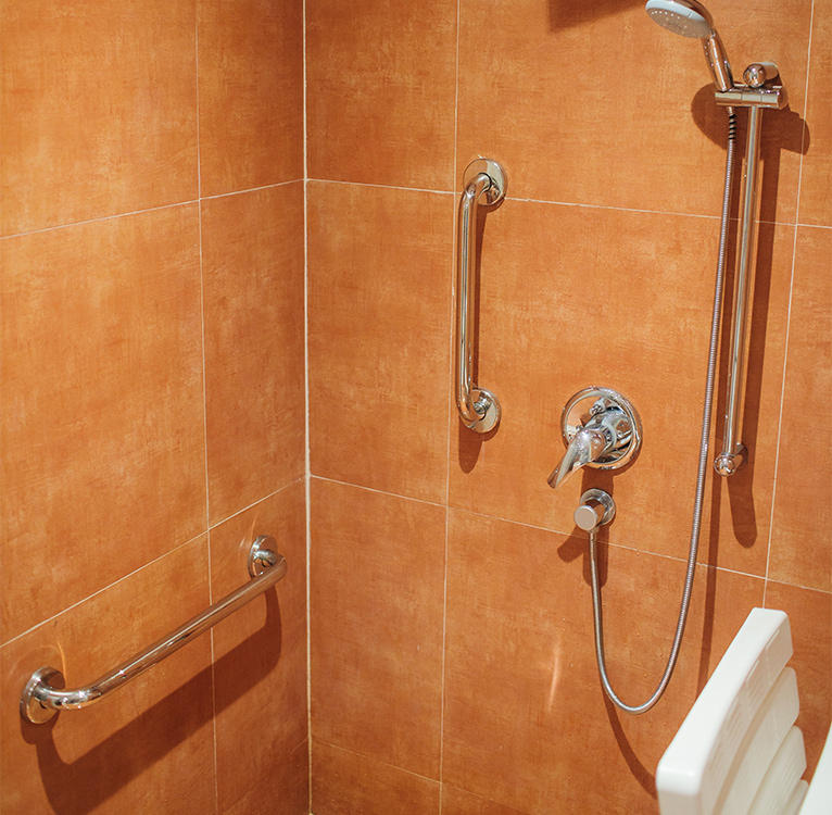 Orange shower with metal grab rails