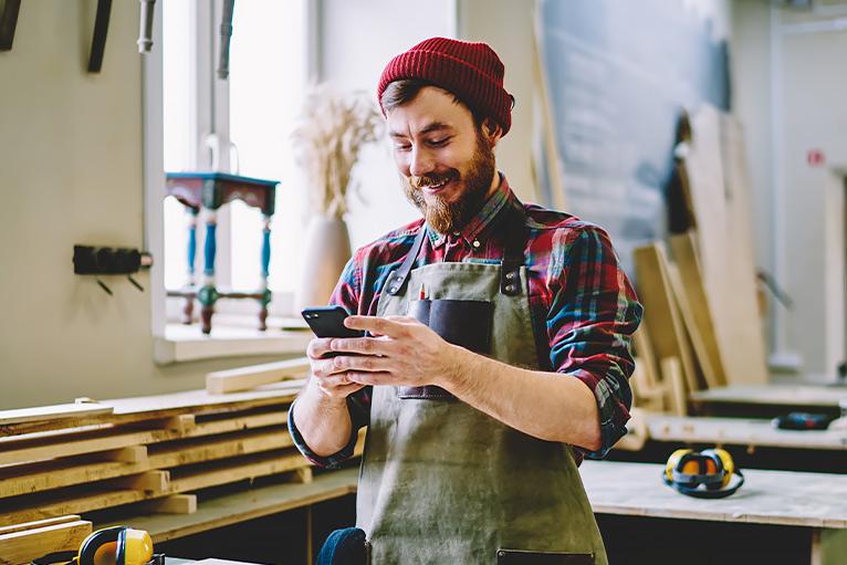 Tradesperson using a smartphone