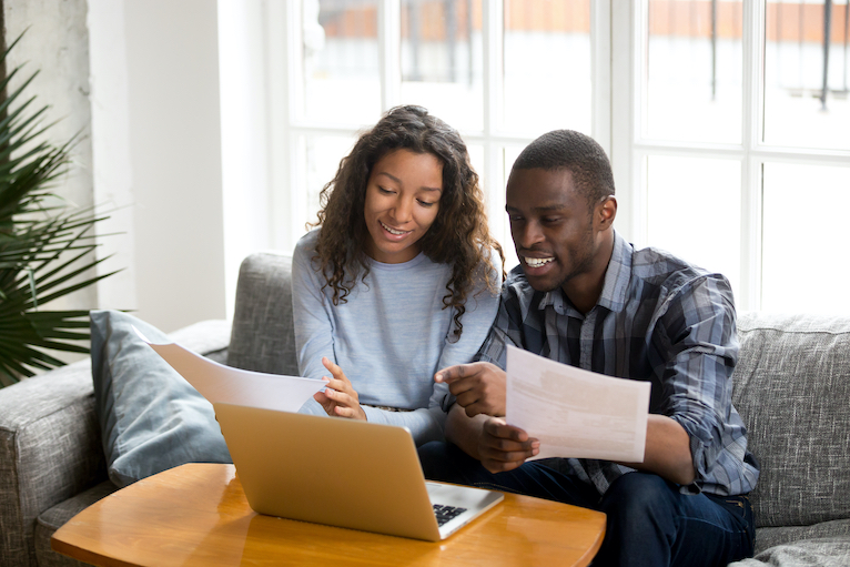 Couple looking at their house insurance policy documents