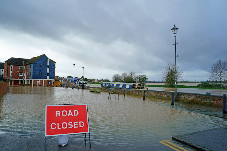 Storm damage: Flooded road in Tewkesbury, Gloucestershire following Storms Dennis and Ciara