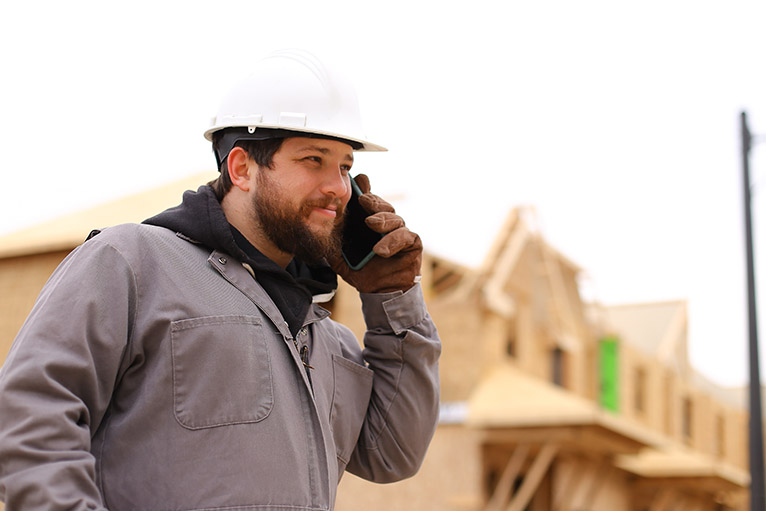 Tradesman using the phone outdoors