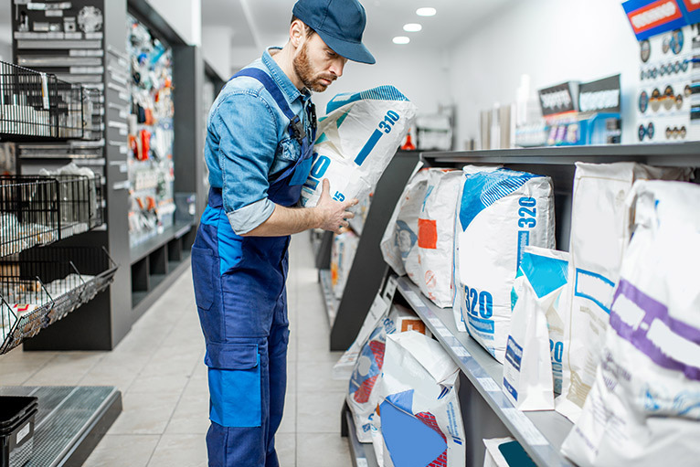 Tradesperson looking at products in builders' merchant