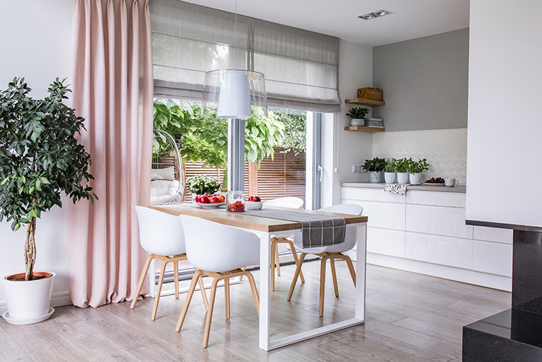 Kitchen with grey blinds and pink curtains