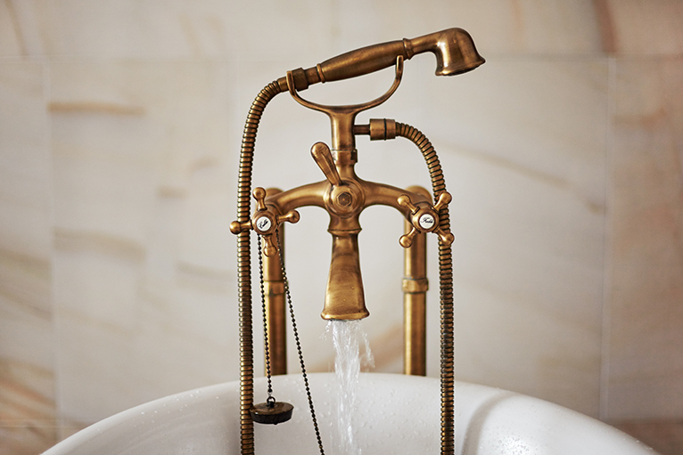 Antique bronze taps in bath