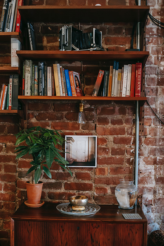 Bookshelf against exposed brick wall