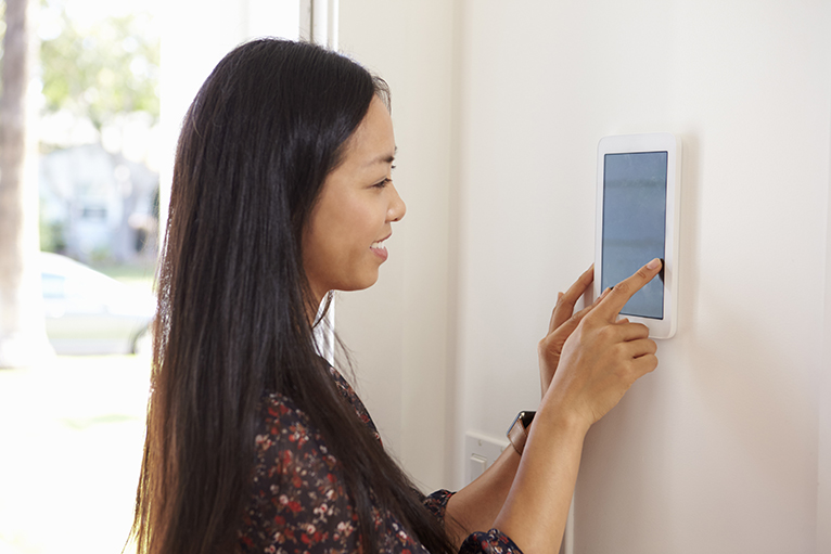 Homeowner using touchpad home security system
