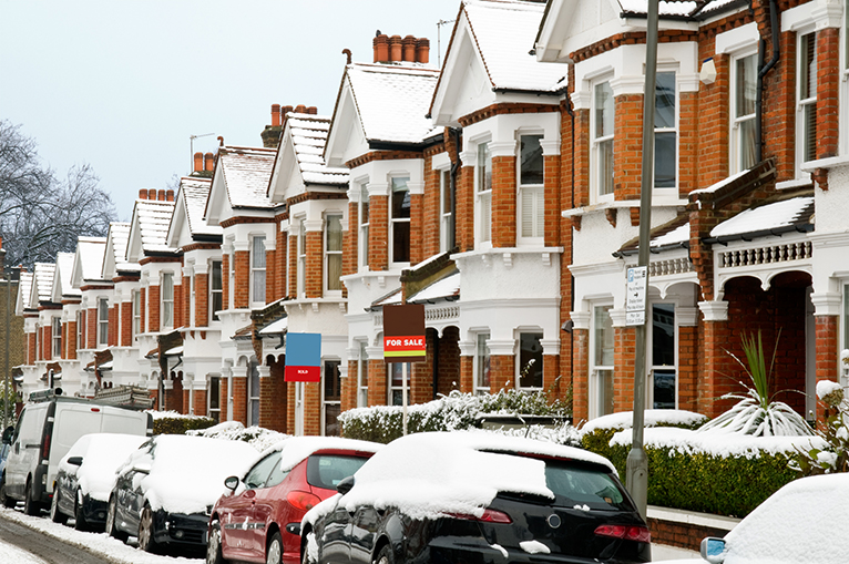 Snow-covered terrace of houses