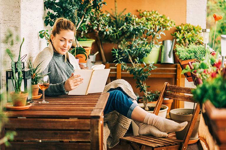 Person reading a book in the garden
