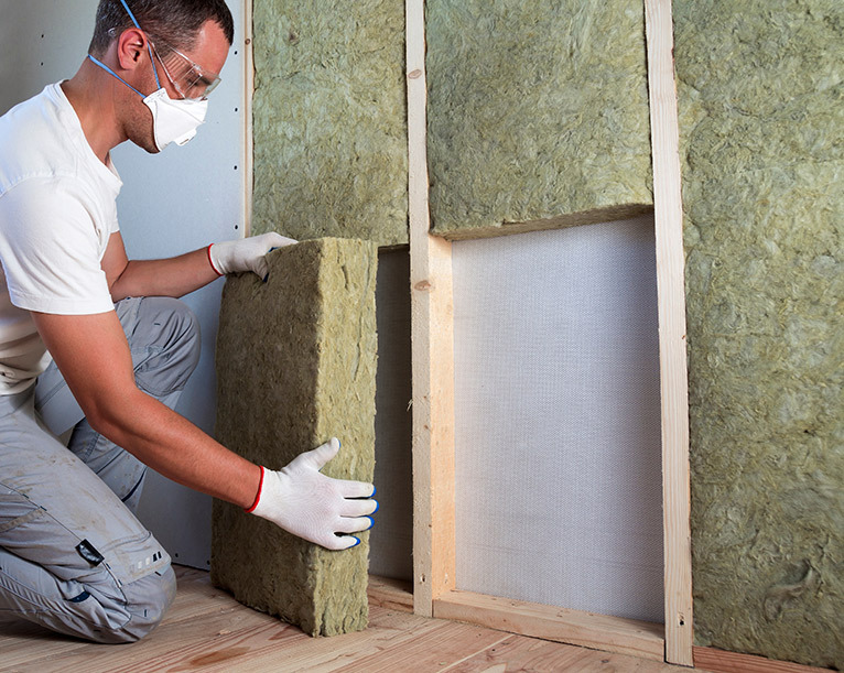 Soundproofing specialist installing soundproofing insulation